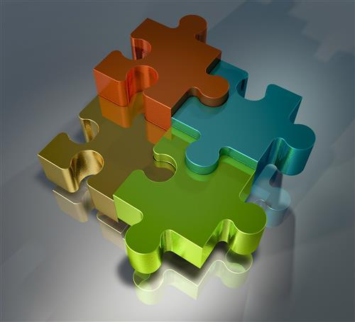 Four shiny, interlocking puzzle pieces of various colors