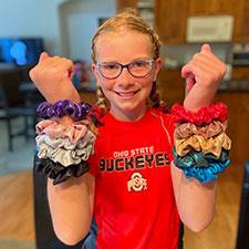 Riley with lots of scrunchies on her wrists
